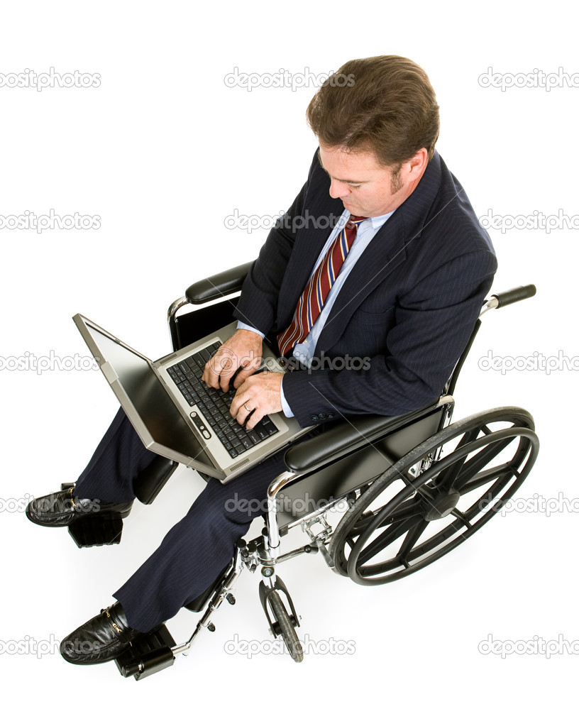 Businessman in a wheelchair working on his laptop computer.  Full Body isolated on white. — Stock Photo #6673182