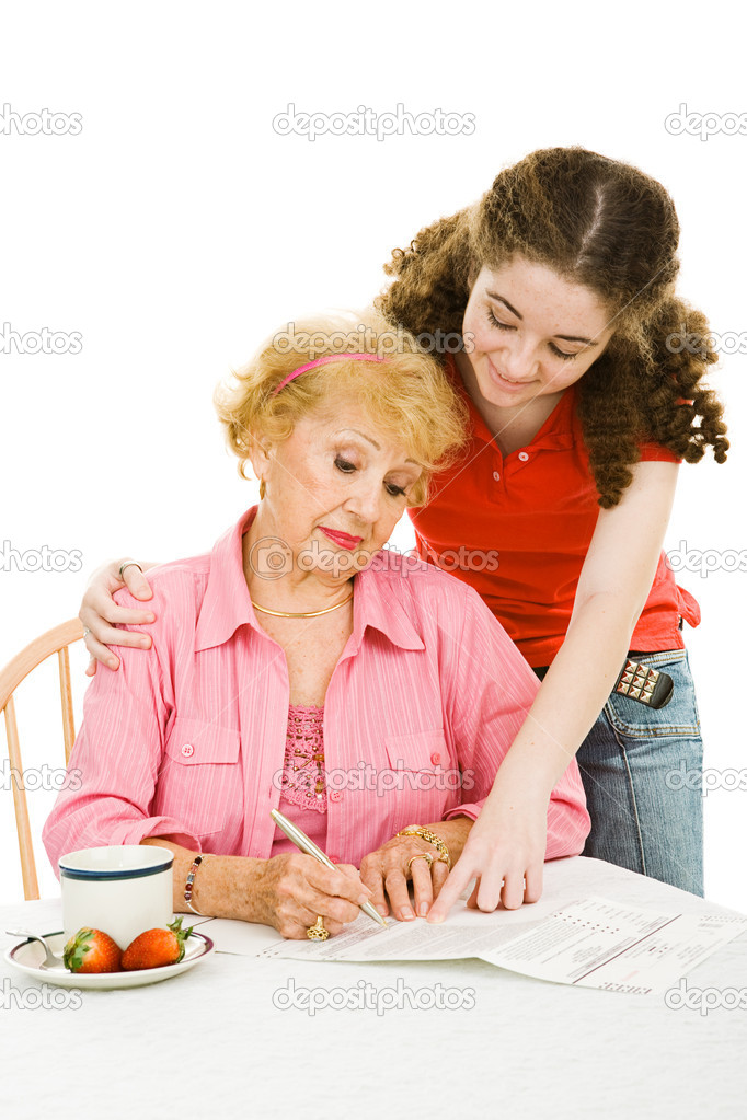 Teen girl helping her grandmother fill out paperwork or absentee ballot.  Isolated on white.  Stock Photo #6673733