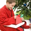 Child Opening Christmas Gift — Stock Photo