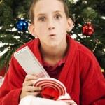 Opening Christmas Stocking — Stock Photo