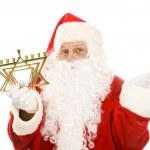 Santa Confused by Menorah — Stock Photo