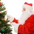 Santa Decorating Christmas Tree — Stock Photo #6684614