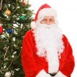 Santa Sitting Under Christmas Tree — Stock Photo