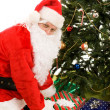 Santa Under Tree with Presents — Stock Photo