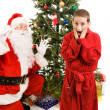 Surprised by Santa Claus - Stock Photo