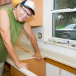 Stock Photo: Contractor Remodeling Kitchen