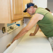 Contractor Installs Laminate Counter — Stock Photo