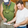 Stock Photo: Contractors Check Plans