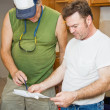 Contractors Check Plans — Stock Photo