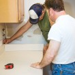 Contractors and Kitchen Counter — Stock Photo