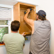 Installing Cabinets - Teamwork — Stock Photo #6684930