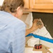 Setting Tiles with Care — Stock Photo