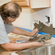 Tile Setter Applying Mortar - Stock Photo