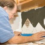 Tile Worker Sets Tile — Stock Photo