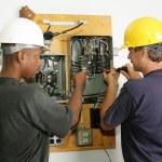 Постер, плакат: Electricians Repair Panel