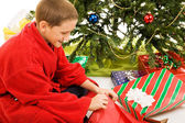 Boy Opens Christmas Present — Stockfoto
