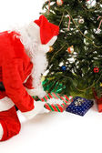 Santa Puts Gifts Under The Tree — Stock Photo