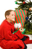 Shaking the Christmas Gift — Stock Photo
