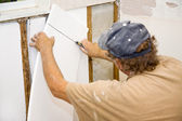 Contractor Installing Insulation — Stock Photo