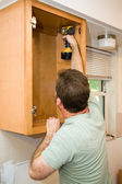 Installing Cabinets — Stock Photo