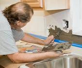 Tile Setter Applying Mortar — Stock Photo