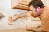 Tile Worker Wipes Grout — Stock Photo