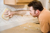 Tilesetter Wipes Down Tile — Stock Photo