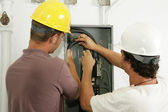 Electricians Install Panel — Stock Photo