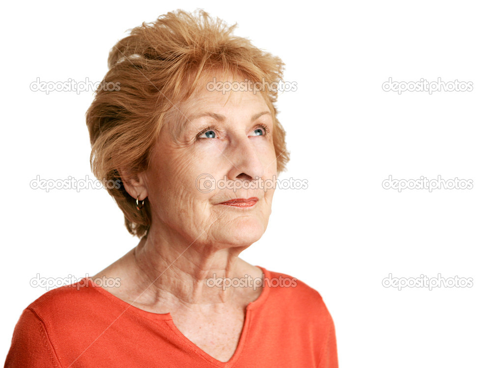 A beautiful red haired senior lady daydreaming with a hopeful expression.  Isolated on white. — Stock Photo #6685127