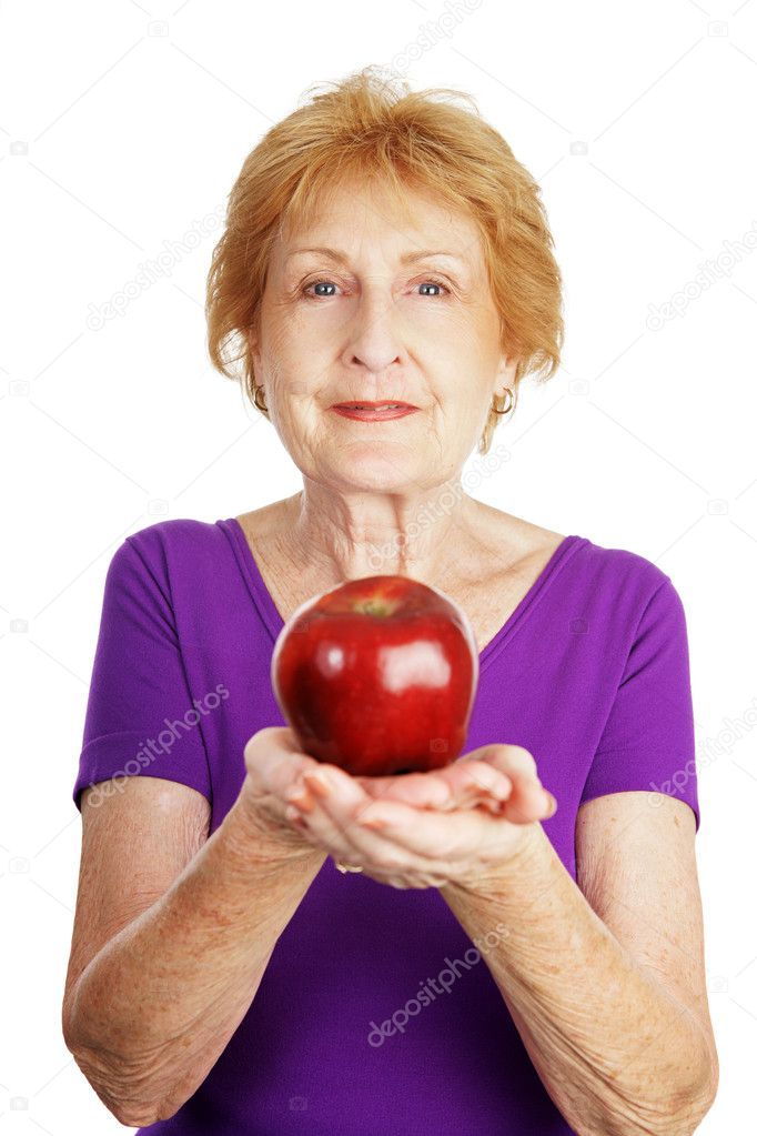 Fit healthy senior lady holding a shiny red apple.   Isolated on white.   — Stock Photo #6685142