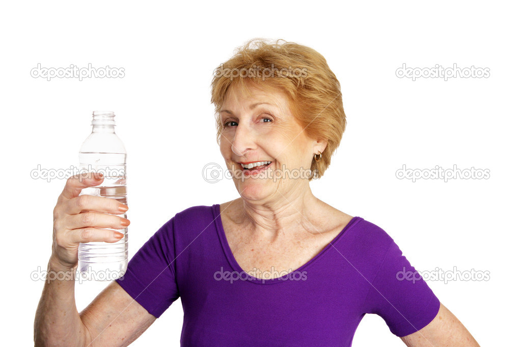 Fit senior lady in a leotard about to drink a bottle of water.  Isolated on white.   — Stock Photo #6685153