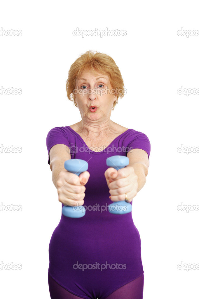 A healthy, fit seventy year old woman working out with freeweights.  She is exhaling. — 图库照片 #6685155