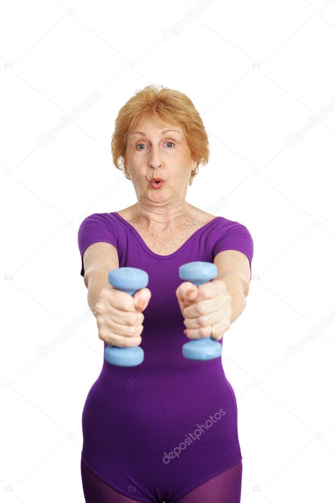A healthy, fit seventy year old woman working out with freeweights.  She is exhaling. — Stock fotografie #6685155