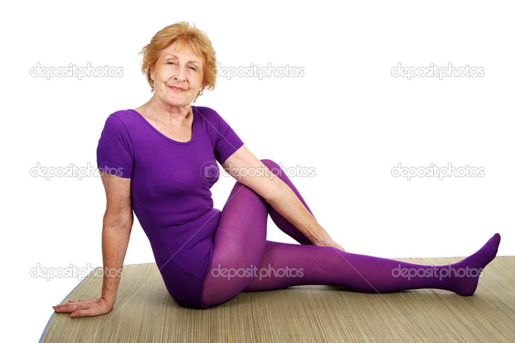 Fit senior woman doing yoga — Stock Photo #6685179
