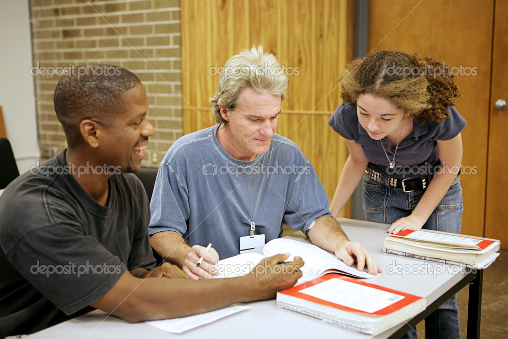 A group of diverse adult education students going over an assignment. — Stock Photo #6685634