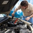 Auto Mechanic - Jumper Cables - Stock Photo