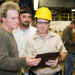 Factory Workers Internal Audit - Stock Photo