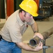 Metal Worker Measures Pipe — Stock Photo