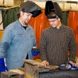 Stock Photo: Welders Discussing Job