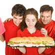 Hungry Partiers with Sandwich — Stock Photo