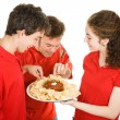 Partiers Enjoy Appetizer — Stock Photo
