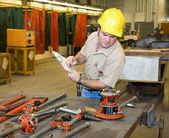 Inspecting Tools — Stock Photo