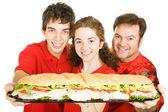 体育迷们与巨型三明治 — 图库照片