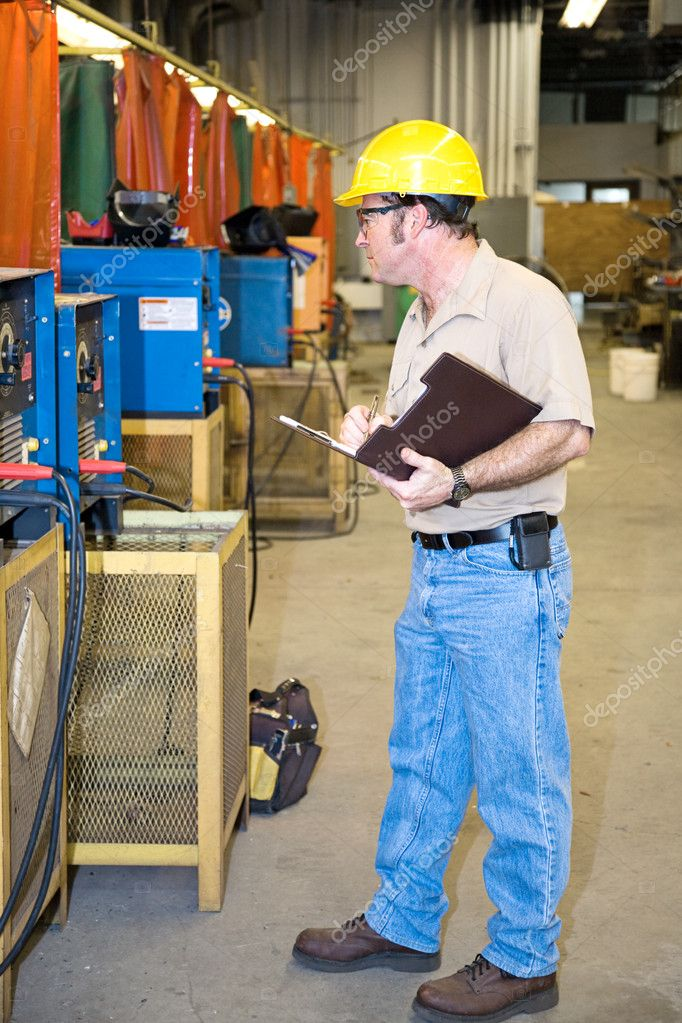 Inspector performing a safety Check of welding equipment in a metal work factory.   — Stock Photo #6696306