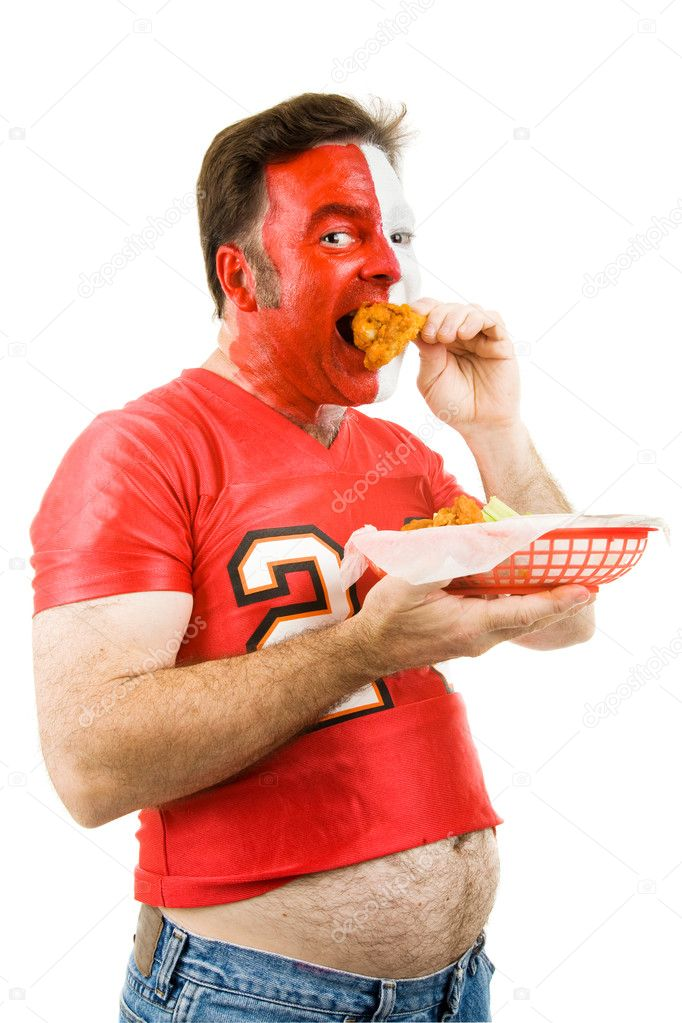 Overweight middle aged sports fan chows down on fried chicken wings.  Isolated on white.  — Stock Photo #6697015