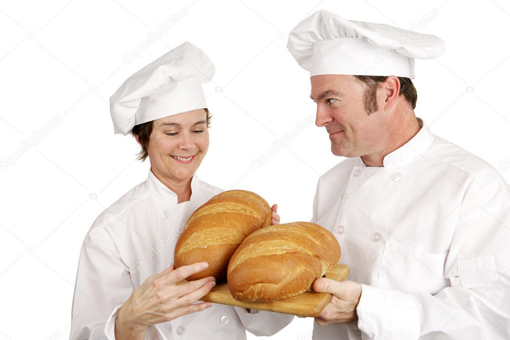 Mature female chef impressed with the baking of a student.  Isolated on white — Stock Photo #6697237