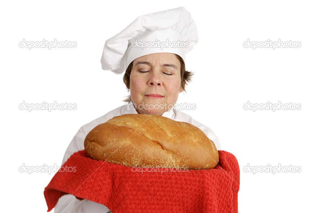 Female chef inhaling the aroma of fresh baked italian bread.  Isolated on white — Stock Photo #6697242