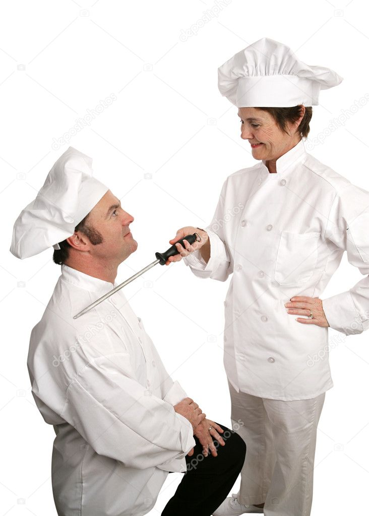 A humorous photo of a new chef being knighted by his cooking school instructor.  Isolated on white. — Stock Photo #6697373