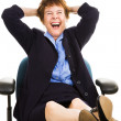 Businesswoman at Desk - Laughing — Stock Photo #6700876