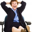 Businesswoman at Desk - Laughing — Stock Photo